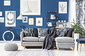 Blue flat with corner sofa and a gallery