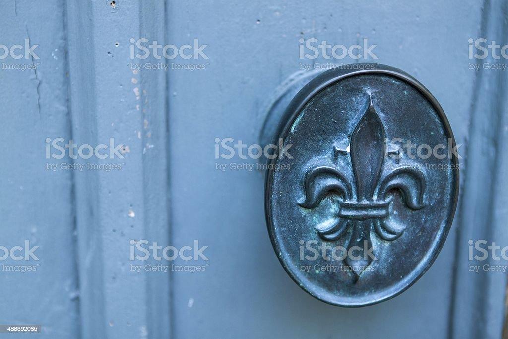 Blue fleur-de-lis doorknob horizontal stock photo