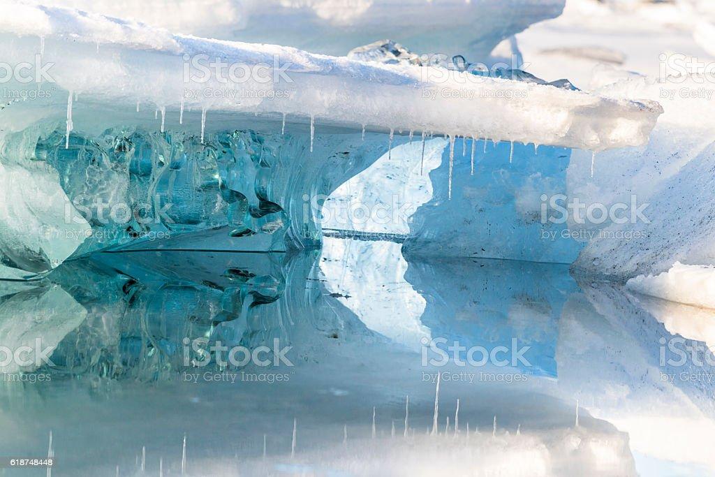 Blue floe reflected, Jokulsarlon Glacial lagoon. Iceland. Winter. stock photo