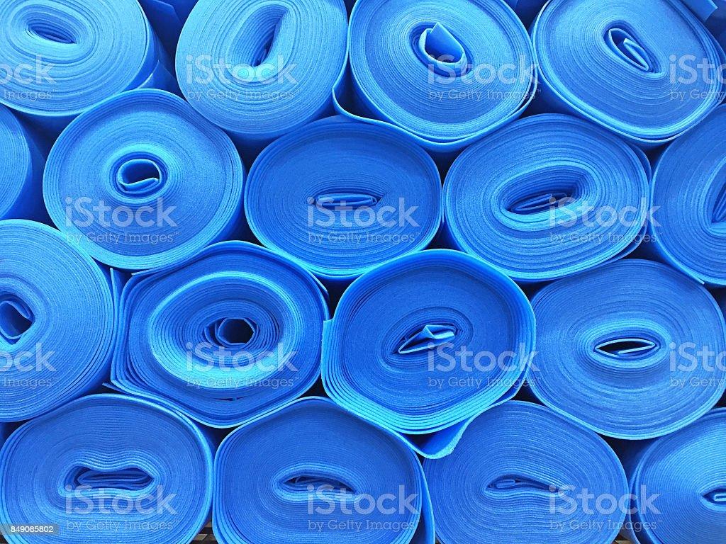 Blue flooring underlay rolls stock photo