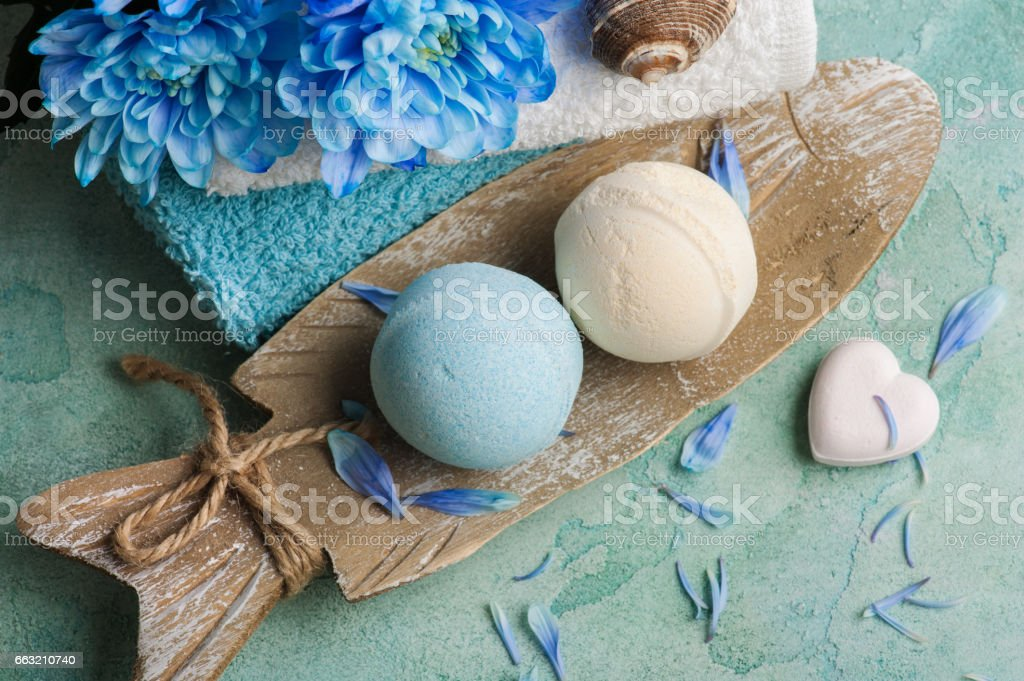 Blue flowers and bath bombs stock photo