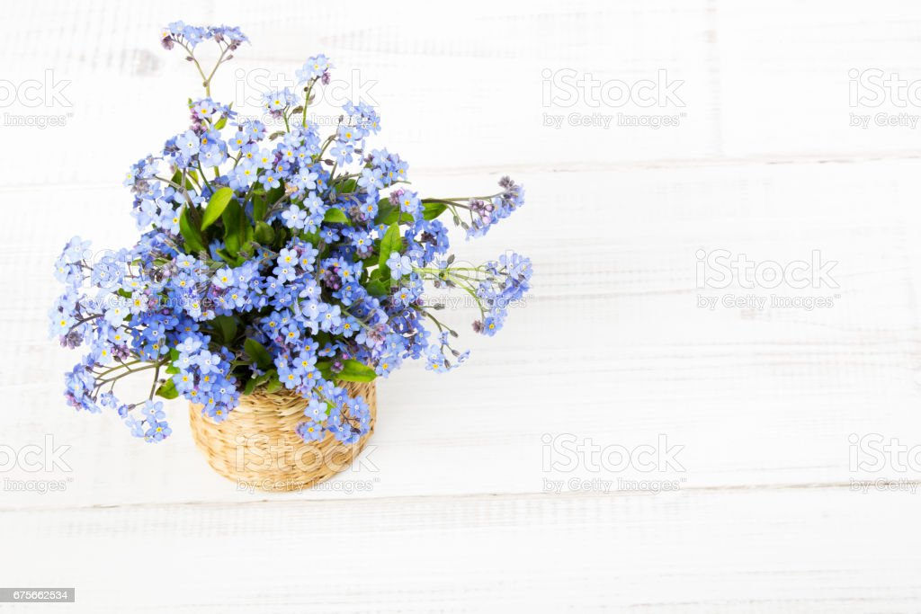 blue flowers bouquet on white wooden background royalty-free stock photo