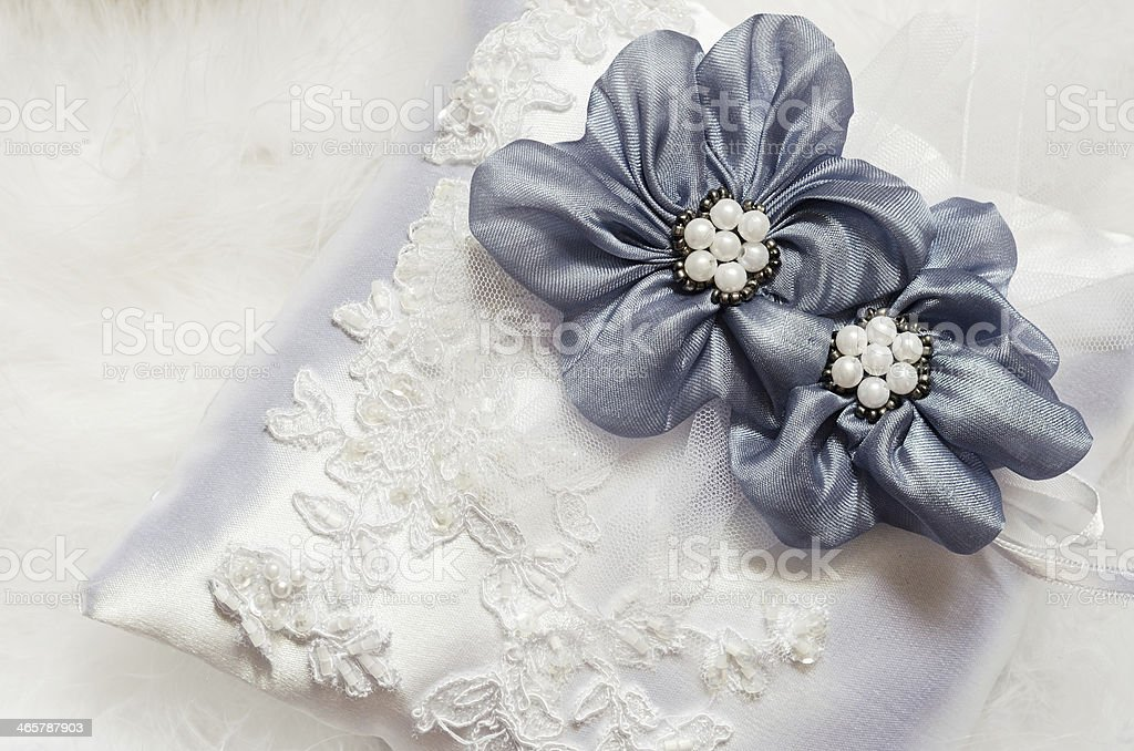 Blue flowers on satin pillow stock photo