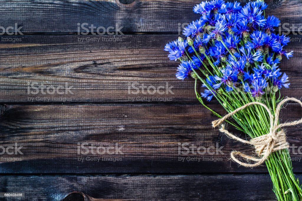 Blue flowers, summer wildflowers bouquet on wooden background, copy space stock photo