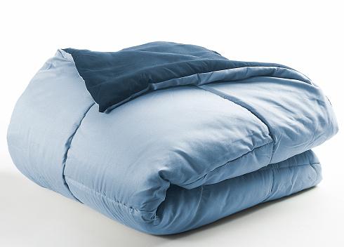 blue folded duvet on a white background