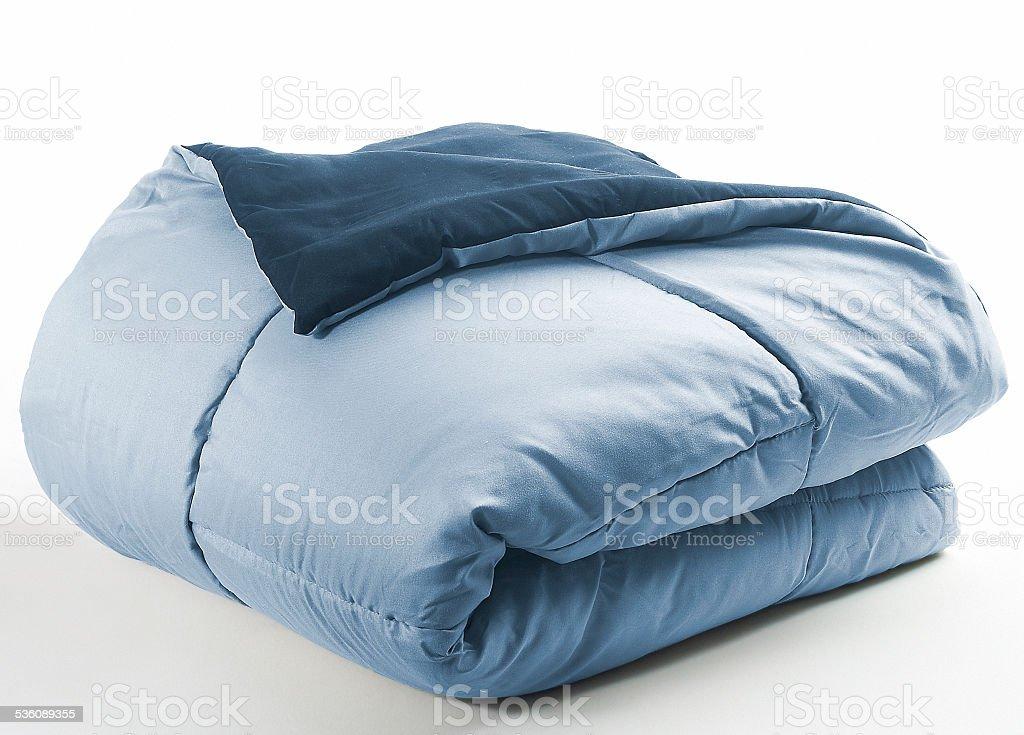 blue folded duvet stock photo