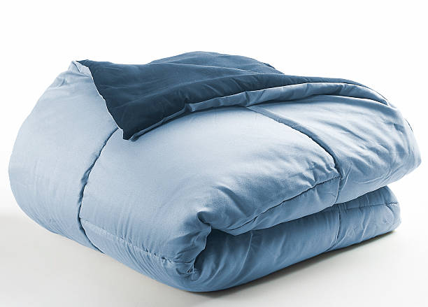 blue folded duvet stock photo
