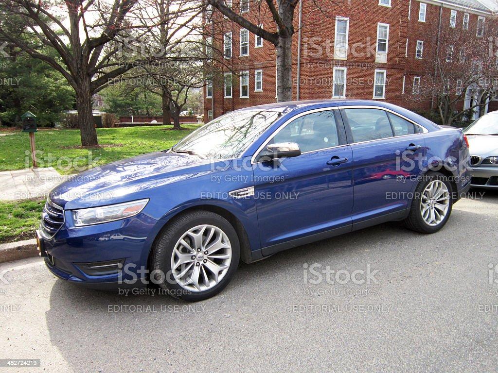Blue Ford Taurus stock photo