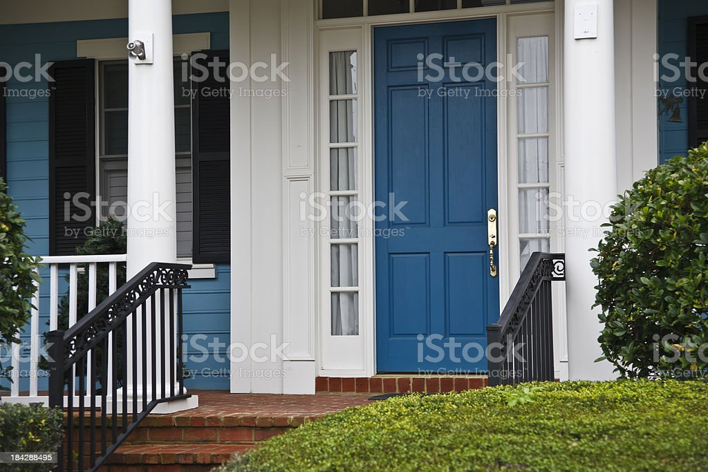 Blue front door in a classic home stock photo