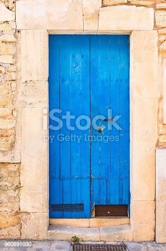 Closeup of blue wooden door of mediterranean house entrance