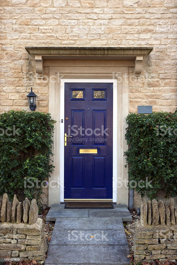 A blue front door on a nice looking house stock photo