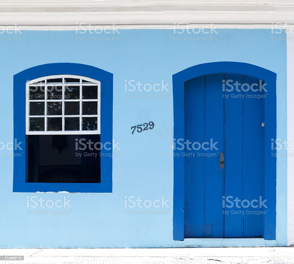 Blue front of traditional fishermen's house in Florianopolis, Brazil. stock photo