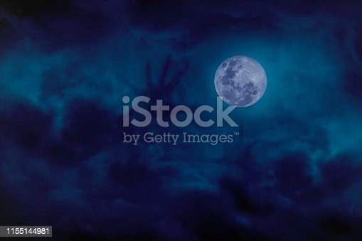 Blue full moon with cloud demon on blue darkness sky, concept of horror and Halloween