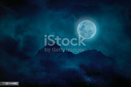 Full moon blue green with mountains and forests in the darkness, Natural scary background
