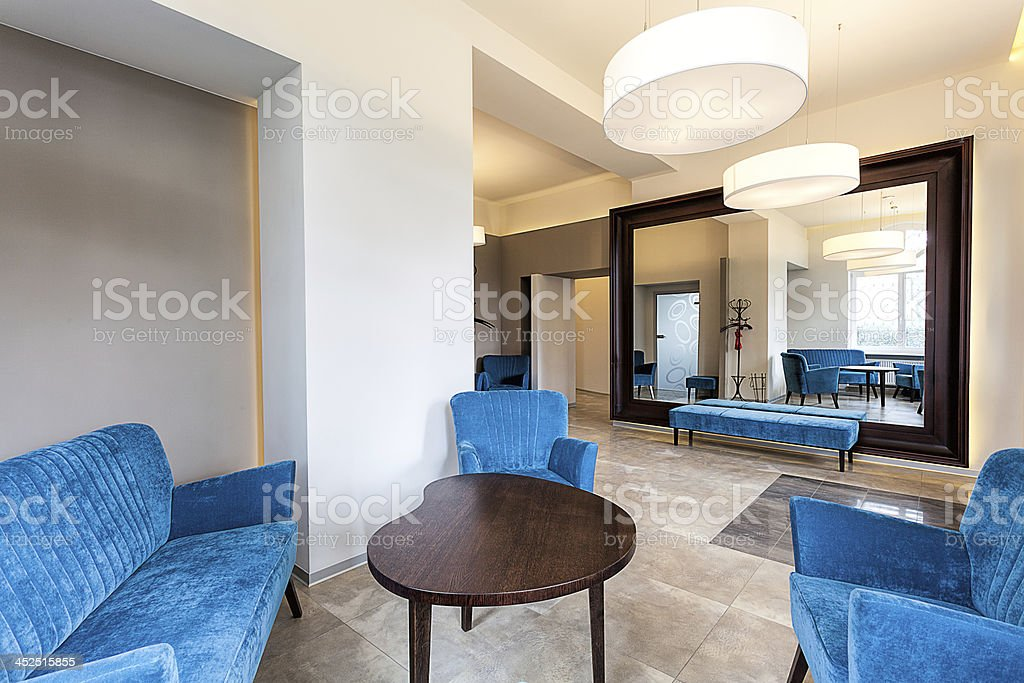 Blue sofa and armchairs in elegant modern interior