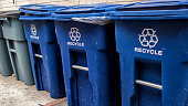 istock Blue garbage bins with the white recycle logo 951776968