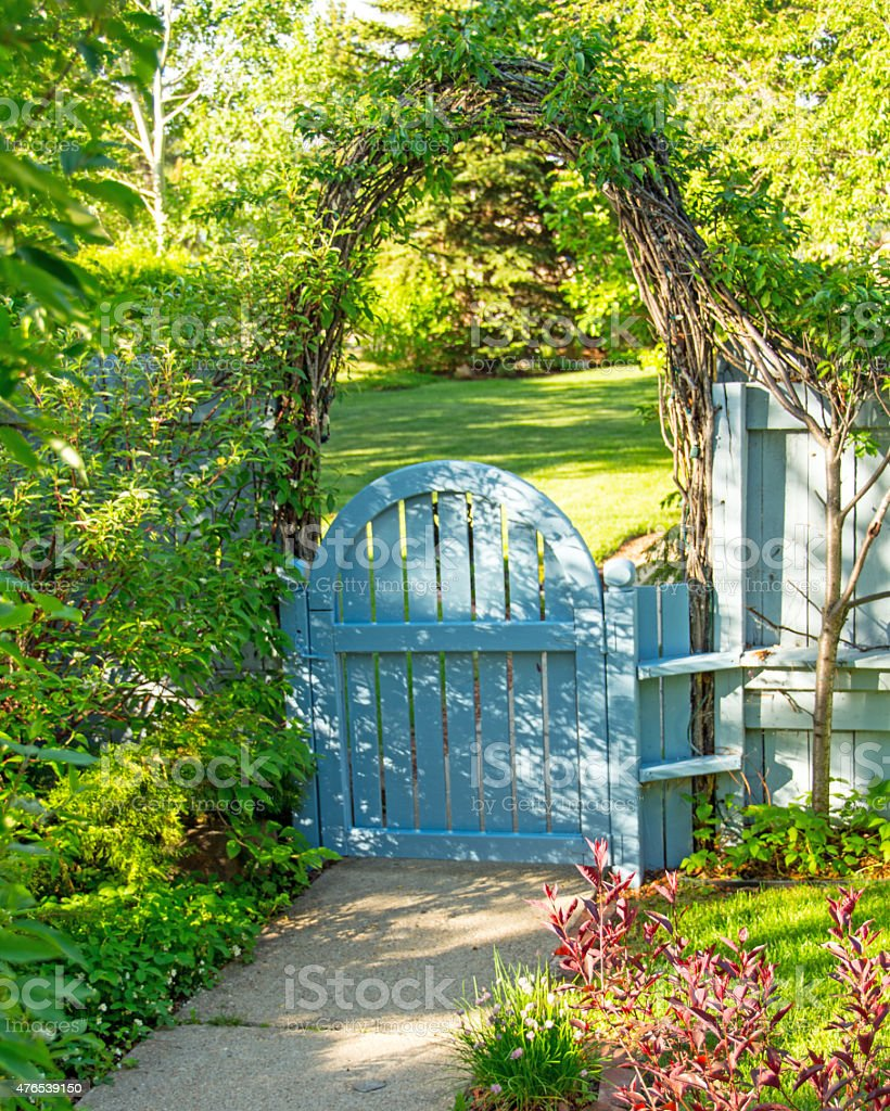 Blue garden arched gate with arch above at home entrance stock photo
