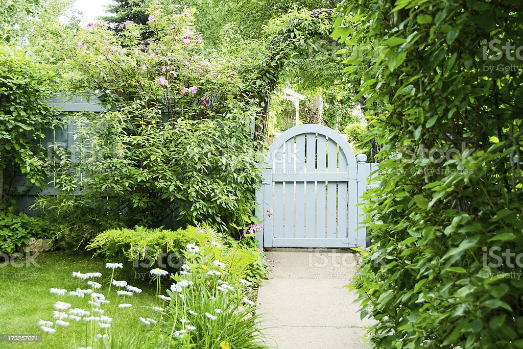 Blue Garden Gate and Spring Flowers stock photo
