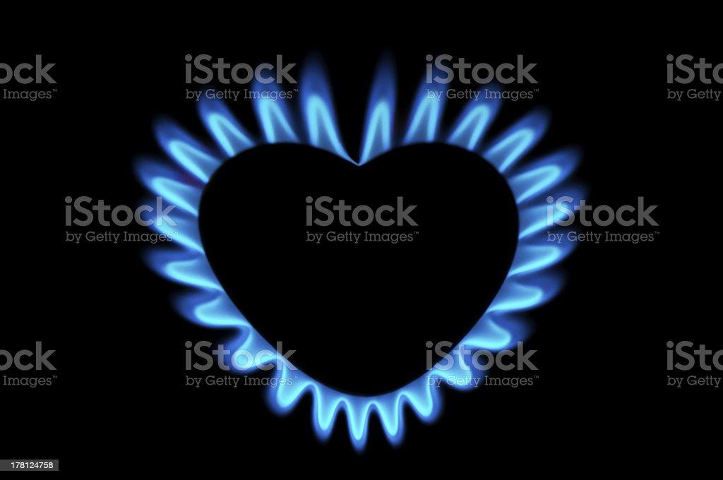 Blue gas burner shaped like a heart on a black background stock photo