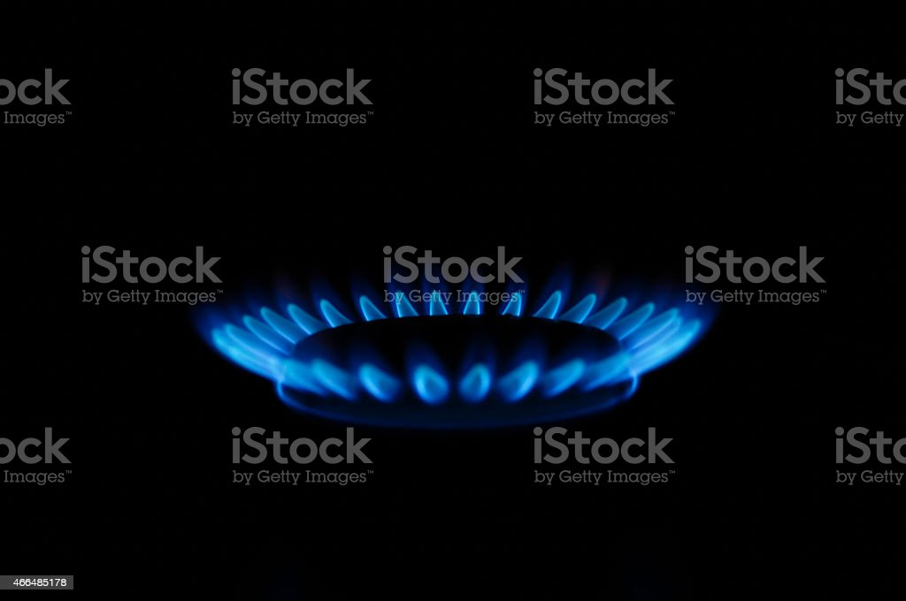 Blue gas fire of cooking stove in the dark stock photo