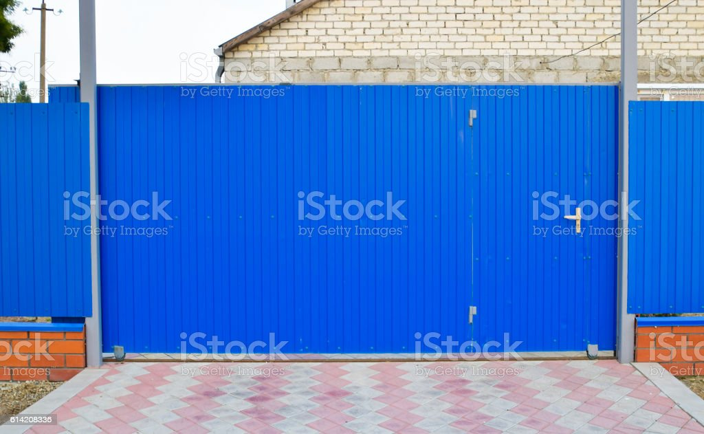 Blue gate and fence stock photo
