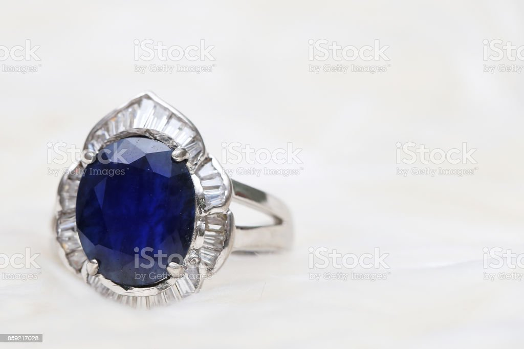 Blue gemstone on silver ring stock photo