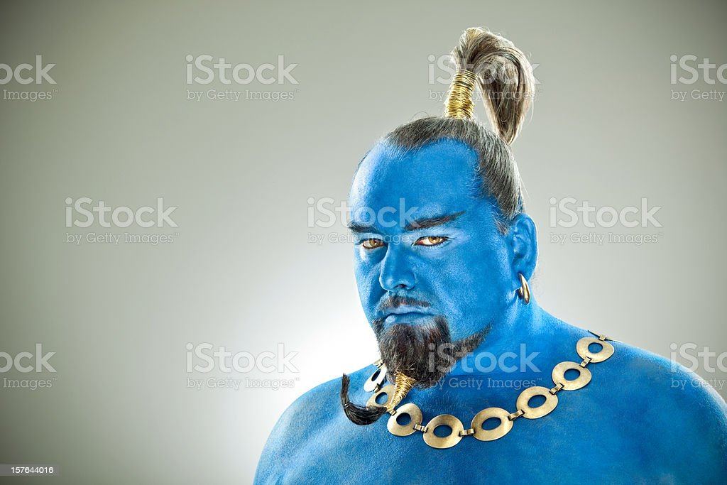 Blue genie out of the lamp close portrait stock photo