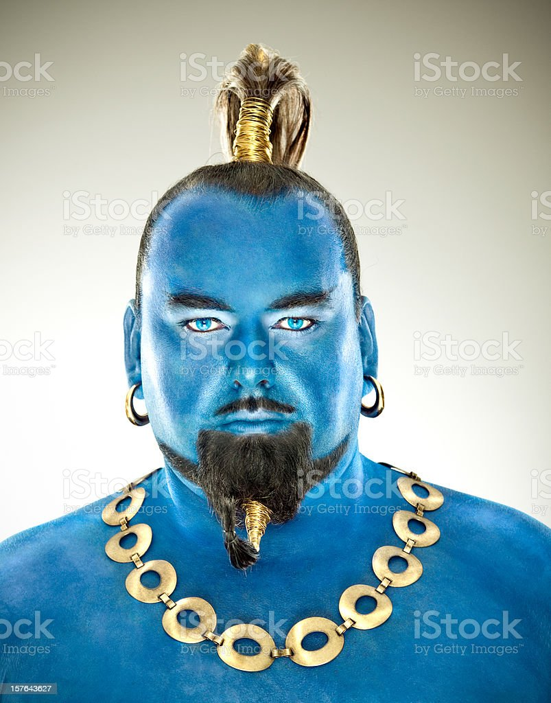 Blue genie out of the lamp front portrait stock photo