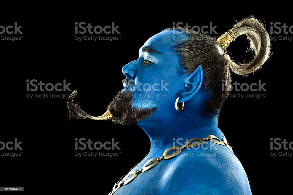 Blue genie out of the lamp on black background stock photo