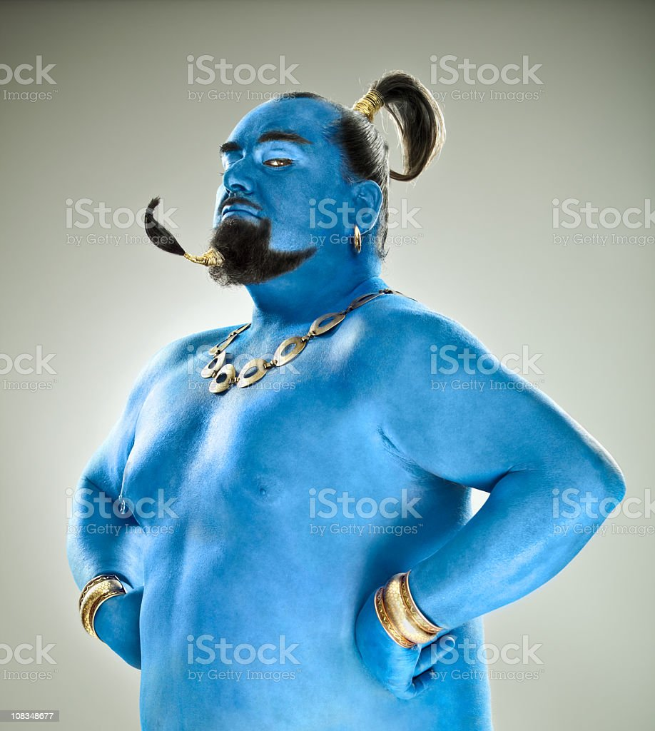 Blue genie out of the lamp royalty-free stock photo