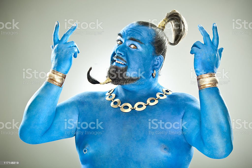 Blue genie out of the lamp stock photo