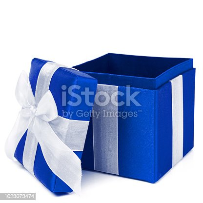 Blue holiday present, ribbon wrapped gift box on a white background.