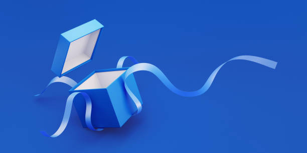 Blue Gift Box Tied with Blue Ribbon Is Being Unwrapped Blue gift box tied with blue ribbon is being unwrapped on blue background. Horizontal composition with copy space. Great use for Christmas and Valentine's Day related gift concepts. gift box stock pictures, royalty-free photos & images