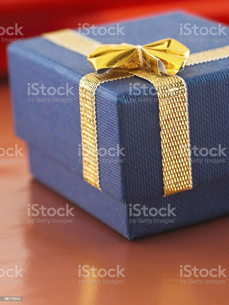Blue gift box with golden bow royalty-free stock photo