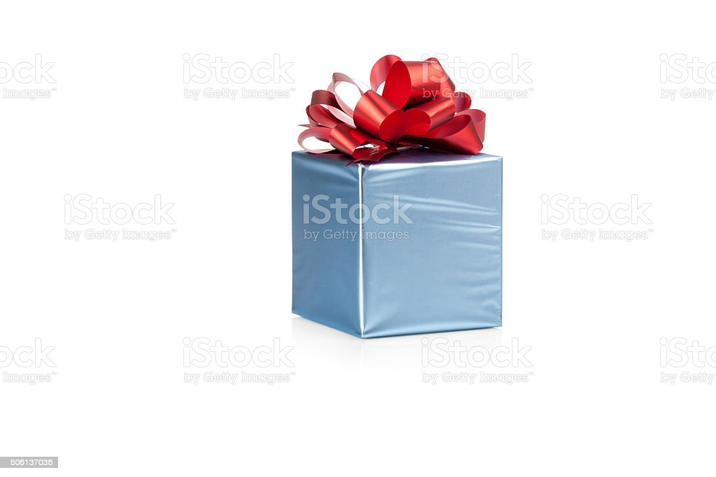 Blue gift box with red ribbon stock photo