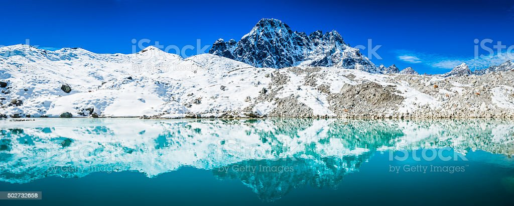 The turquoise melt waters, icy surface and rocky morain debris of the...