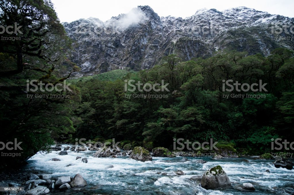 A blue glacier river among the nature with snow mountain. royalty-free stock photo