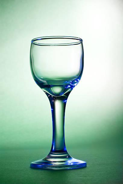 Blue glares on wine glass stock photo