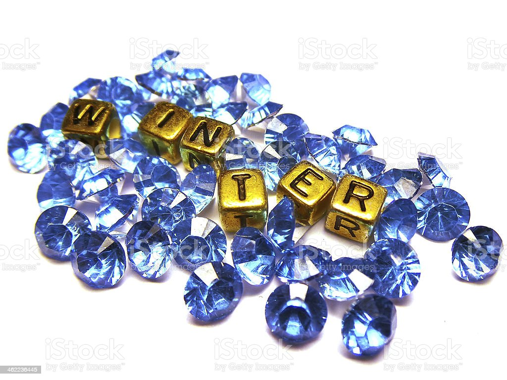 Blue glass crystals with cube gold beads and word winter royalty-free stock photo