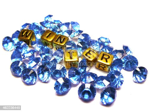 Blue glass crystals with silver back with square or cube gold beads and word