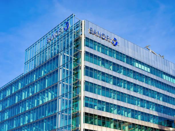 Blue glass European building architecture with Sanofi logo Berlin stock photo
