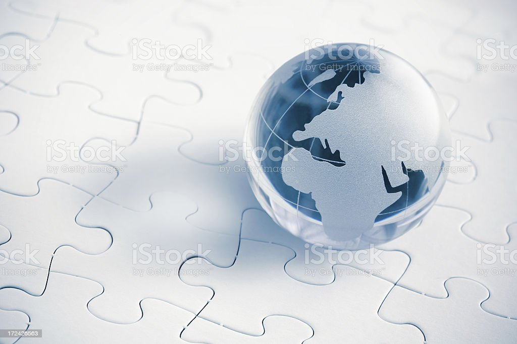 Blue glass Globe with puzzle background royalty-free stock photo