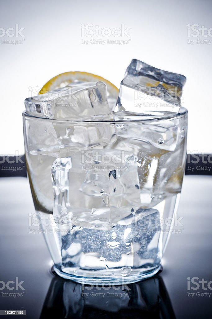 Blue Glass of vodka or water with a lemon royalty-free stock photo