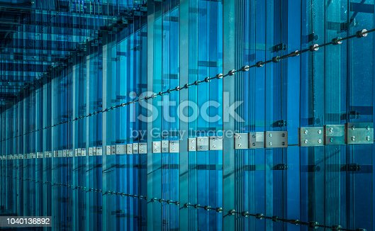 Blue glass and stainless steel background.