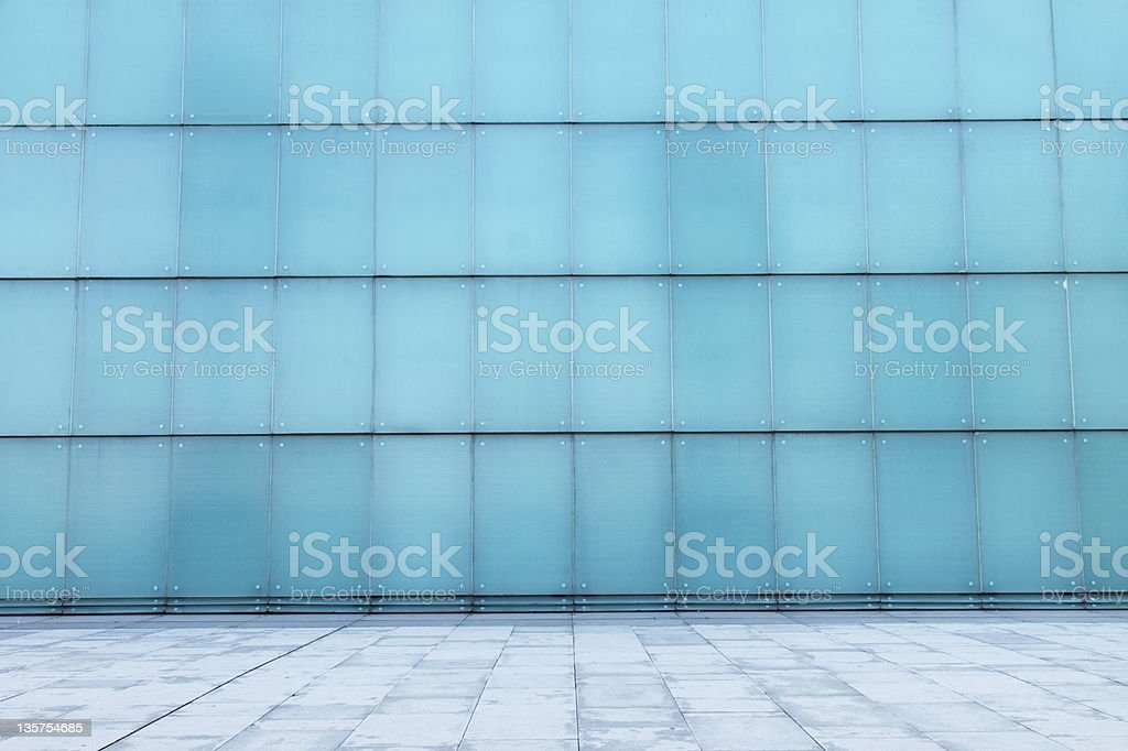 A blue glass wall of a building  royalty-free stock photo