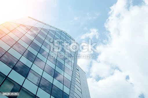 Low angle view of skyscraper. Urban abstract - blue glass wall for background.