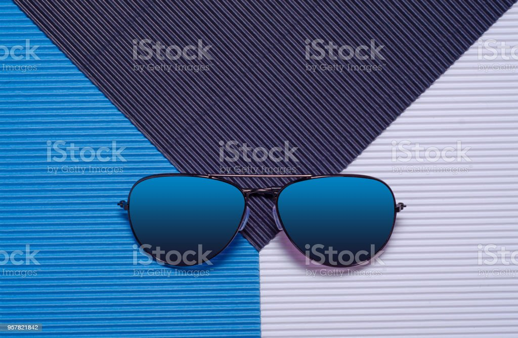 Blue glasses on a blue background, top view. stock photo