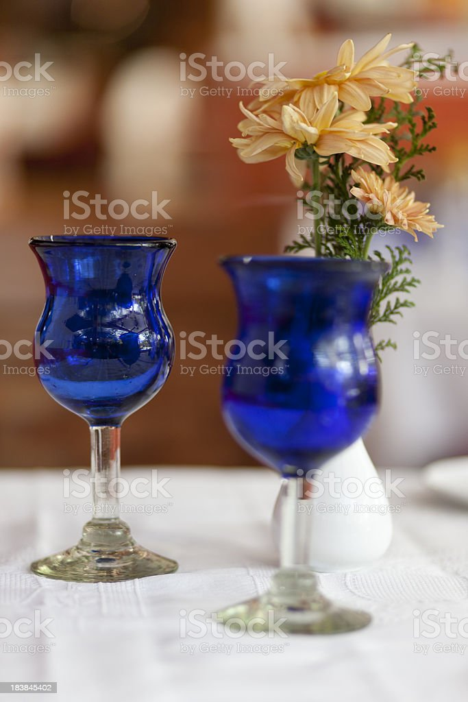Blue Glasses on Table, Flowers in Vase, Fine Dining, Restaurant royalty-free stock photo