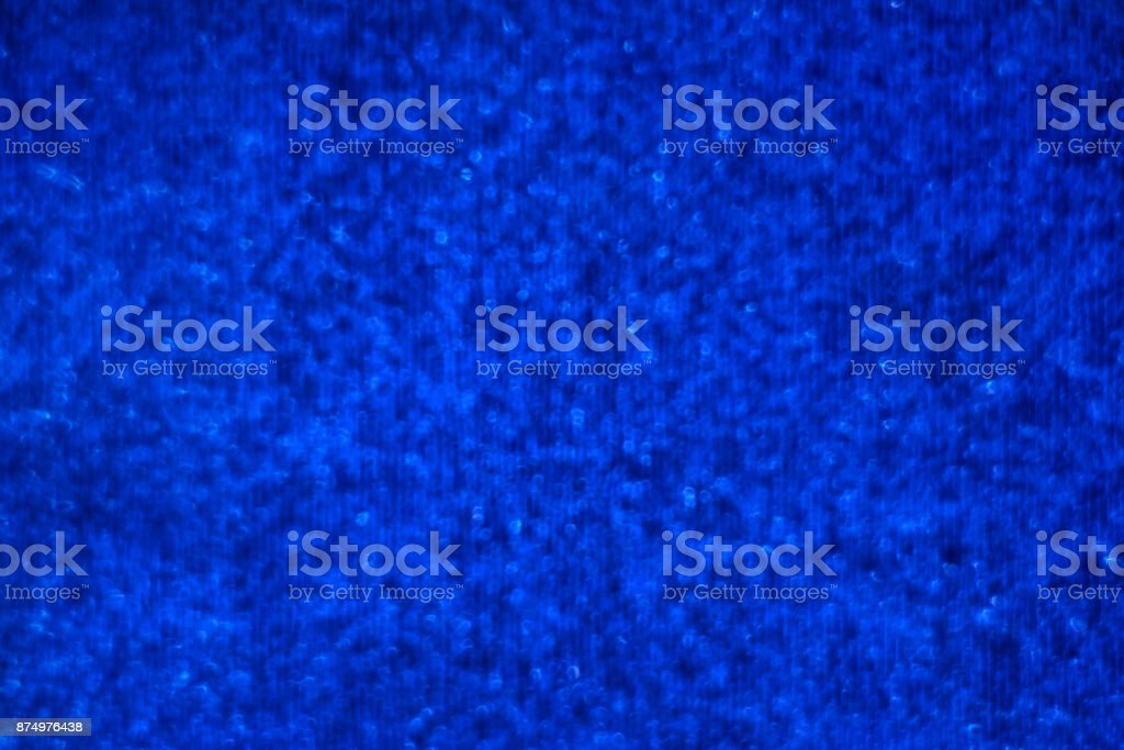 Blue glitter abstract festive background with blur bokeh stock photo
