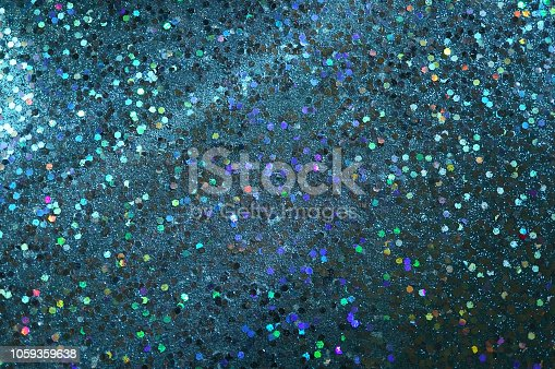 872229066 istock photo Blue glitter background 1059359638